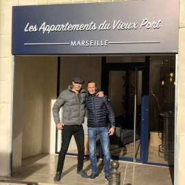 Owner of Les Appartments du Vieux Port at the accommodation entrance in Marseilles, France